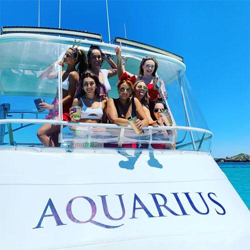 AQUARIUS boat charters girls on bridge