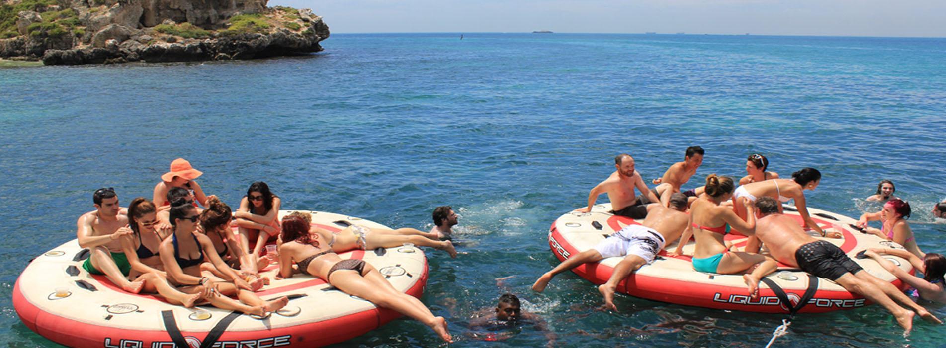 CARNAC ISLAND BOAT CHARTERS people on floaties