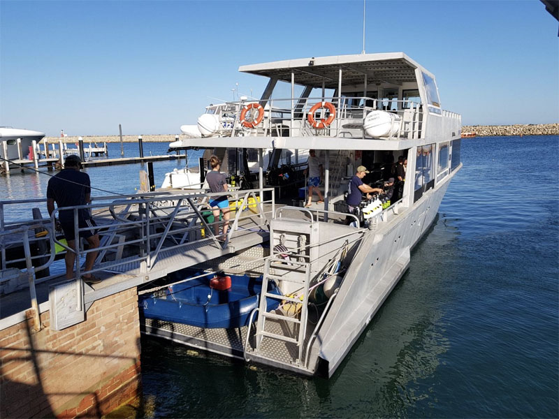 LIONFISH IV Charters loading alcohol on boat