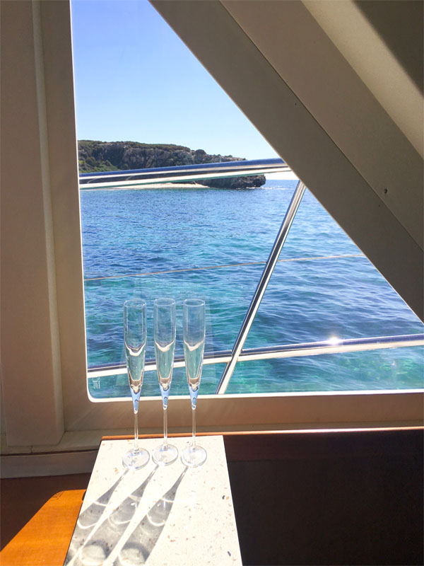 TENACIOUS boat charters champagne glasses boat Carnac