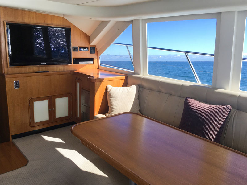 TENACIOUS boat charters perth cabin lounge seating